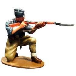 Falange militiaman kneeling firing